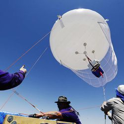 Researchers retrieve an aerostat used to study ozone at Ogden Bay Waterfowl Management Area near the Great Salt Lake  Wednesday, June 17, 2015. The Utah Department of Environmental Quality's air quality scientists and researchers from Utah universities are deploying sensors this summer to detect smog-forming ozone.