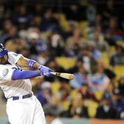 Los Angeles Dodgers' Matt Kemp hits a two-run home run during the fifth inning of their baseball game against the San Diego Padres, Friday, April 13, 2012, in Los Angeles. (AP Photo/Mark J. Terrill)