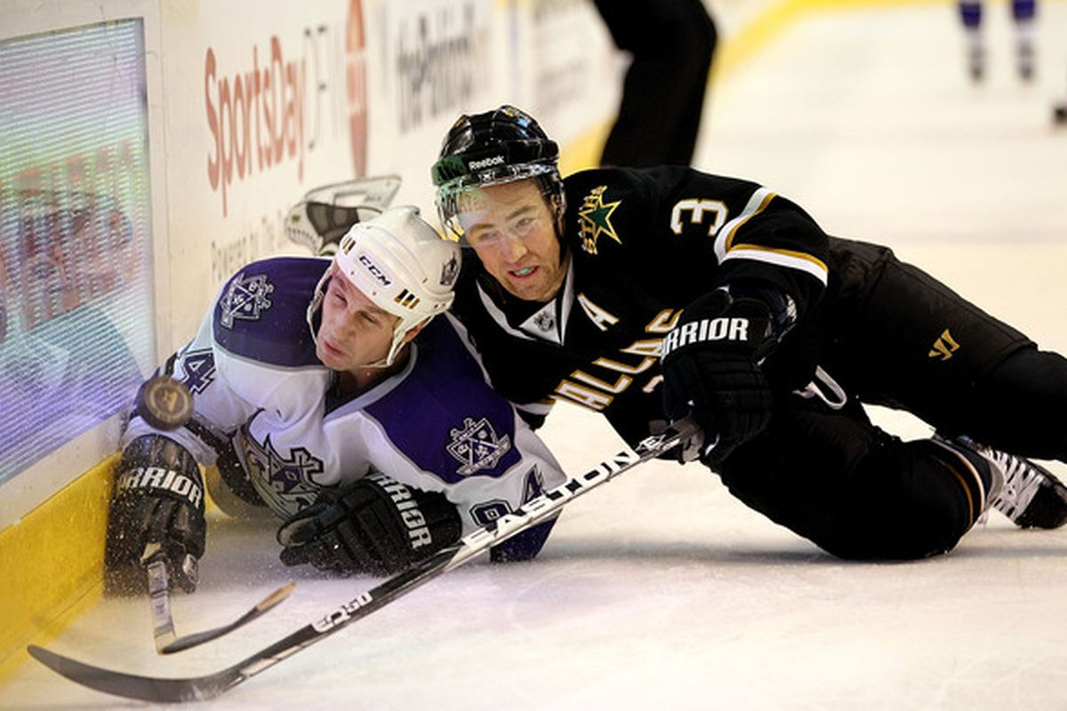 DALLAS TX - JANUARY 17:  Left wing Ryan Smyth #94 of the Los Angeles Kings dives for the puck with Stephane Robidas #3 of the Dallas Stars at American Airlines Center on January 17 2011 in Dallas Texas.  (Photo by Ronald Martinez/Getty Images)