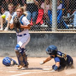 Enterprise'sDykell Jones slides into home during a 2A softball championship game against the Beaver Beavers at Spanish Fork Sports Park on Saturday, May 15, 2021. The Enterprise Wolves won 5-2.