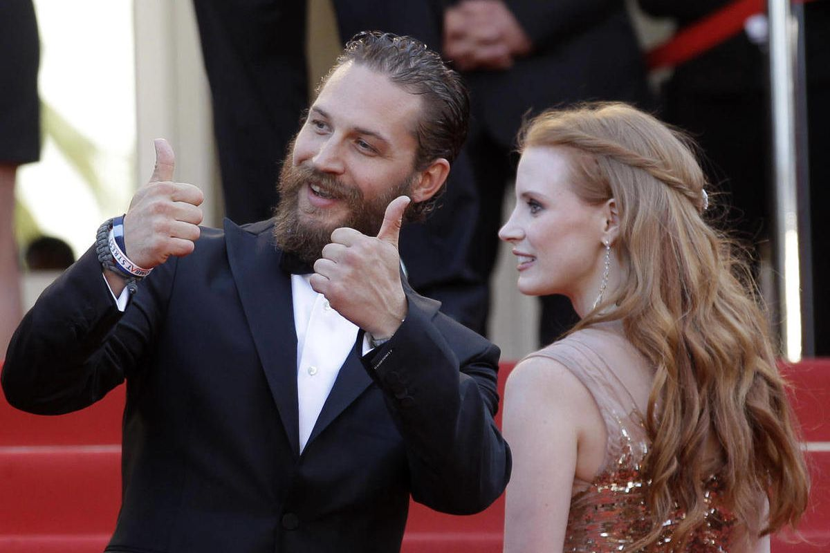 Actors Tom Hardy, left and Jessica Chastain arrive for the screening of Lawless at the 65th international film festival, in Cannes, southern France, Saturday, May 19, 2012. Hardy will be reading bedtime stories with his dog to help soothe viewers during the COVID-19 pandemic.