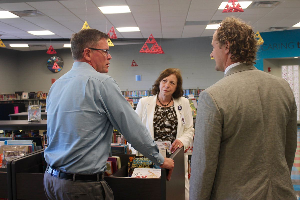 From left: Principal Gary Hughes confers with supervisors Dottie Critchlow and Craig Hammond about the upcoming school year. Critchlow helps oversee support for school leaders under the Nashville district's new supervisory model.