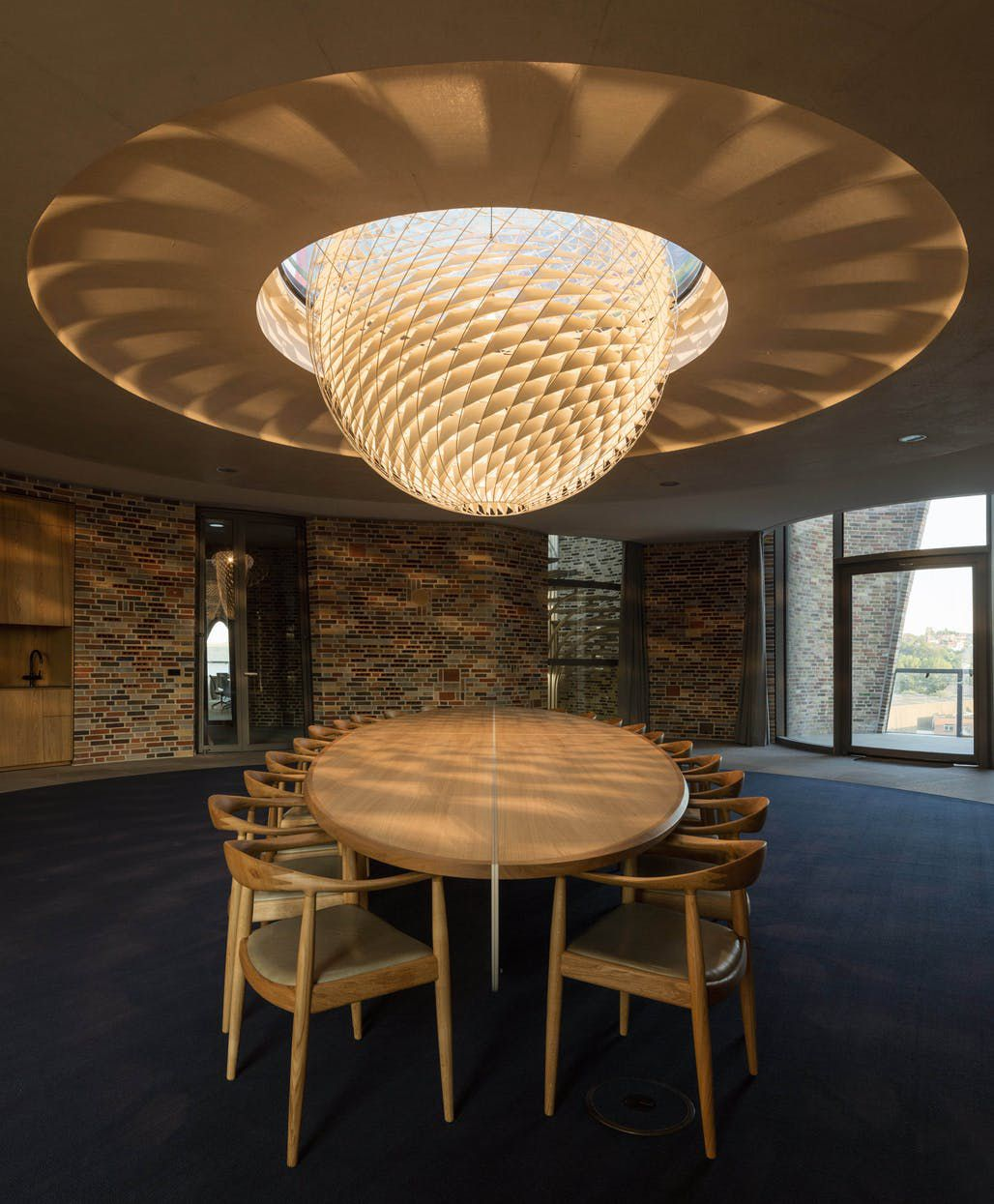 Conference room with large pendant light and table