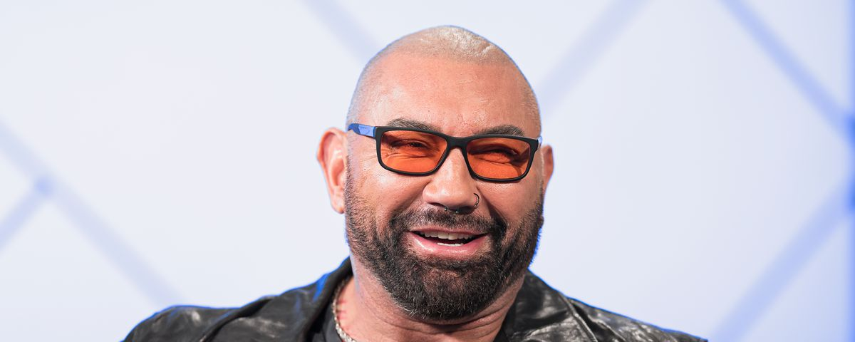 Dave Bautista in orange-lensed glasses and a leather jacket on The IMDb Show in 2020
