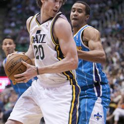 Utah's Gordon Hayward spins to the hoop around New Orleans' Brian Roberts as the Utah Jazz and the New Orleans Hornets play Friday, April 5, 2013 at EnergySolutions Arena in Salt Lake City. Utah won 95-83.
