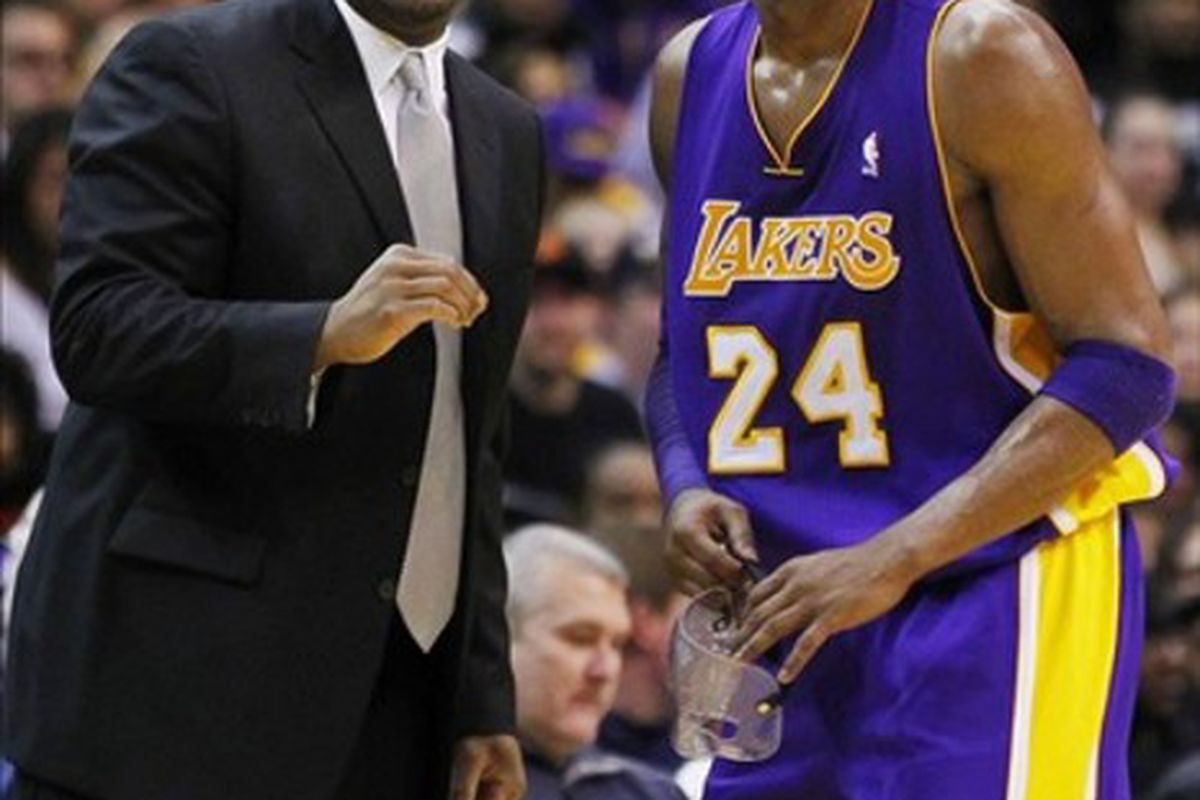 March 7, 2012; Washington, DC, USA; Los Angeles Lakers head coach Mike Brown (l) talks with guard Kobe Bryant (24) against the Washington Wizards in the first half at Verizon Center. The Wizards won 106-101. Mandatory Credit: Geoff Burke-US PRESSWIRE