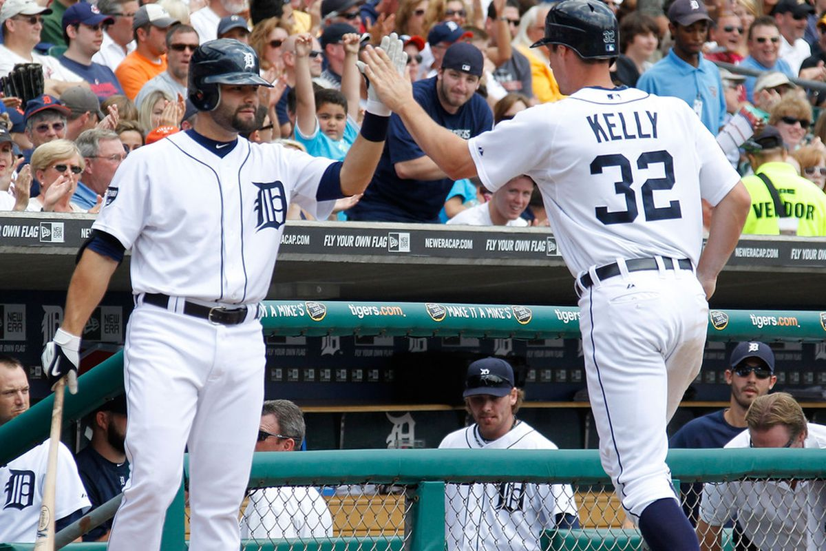 DETROIT, MI - JUNE 16: Don Kelly #32 of the Detroit Tigers high fives Alex Avila #13 after scoring a first inning run while playing the Cleveland Indians at Comerica Park on June 16, 2011 in Detroit, Michigan. (Photo by Gregory Shamus/Getty Images)