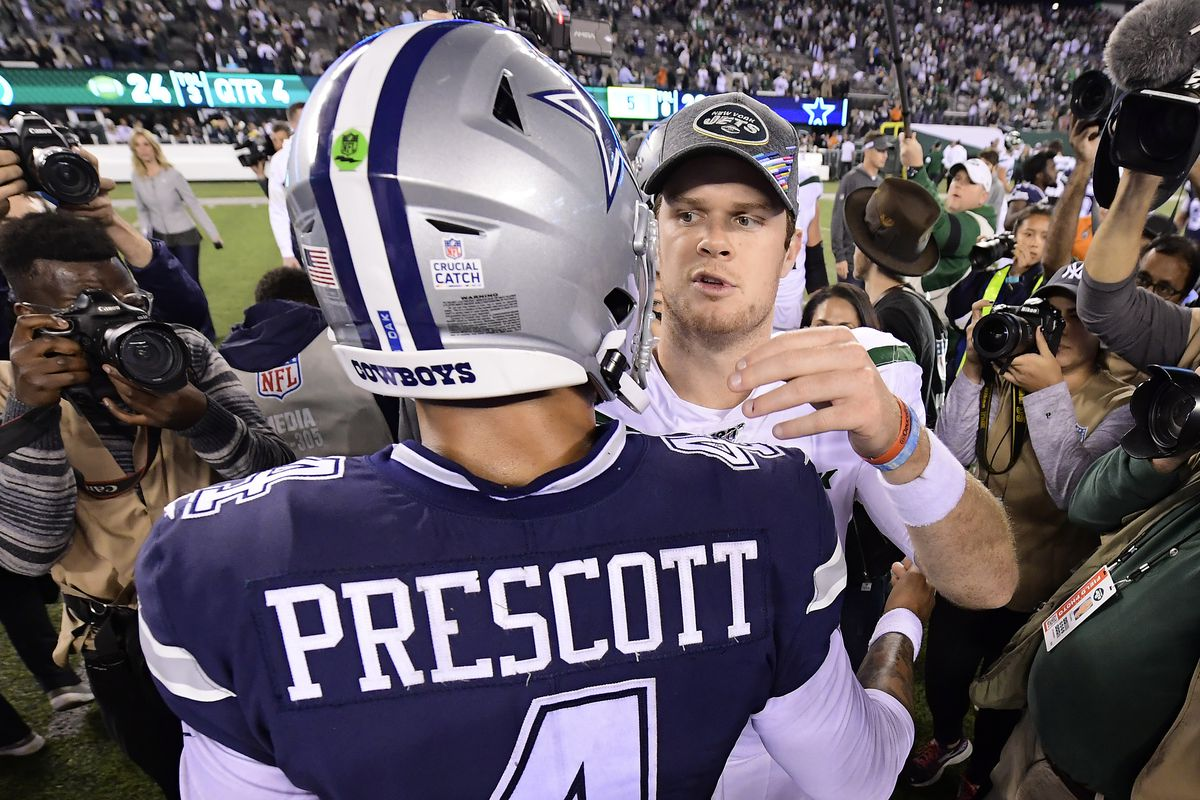 Dak Prescott #4 of the Dallas Cowboys and Sam Darnold #14 of the New York Jets shakes hands after the Jets 24-22 win at MetLife Stadium on October 13, 2019 in East Rutherford, New Jersey.