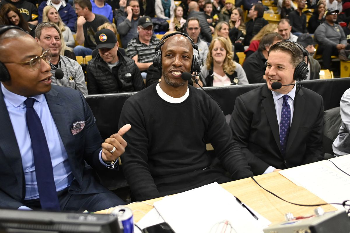 Retired NBA player Chauncey Billups is interviewed during the first half of the game between the Arizona Wildcats against the Colorado Buffaloes at the Coors Events Center.