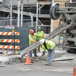Concrete being pouring into a completed utility job on the southeast corner of Waveland and Sheffield in front of Murphy's