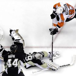 Philadelphia Flyers' Jakub Voracek (93) has a third-period shot blocked by Pittsburgh Penguins goalie Marc-Andre Fleury (29) during Game 2 of an opening-round NHL hockey playoff series in Pittsburgh, Friday, April 13, 2012. The Flyers won 8-5. (AP Photo/Gene J. Puskar)