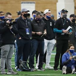 Pro scouts watch during BYU's pro day in Provo on Friday, March 26, 2021.