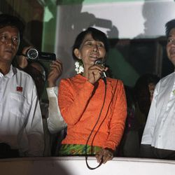Myanmar's pro-democracy leader Aung San Suu Kyi, center, speak briefly to her supporters upon her arrival in the village of Wah Thin Kha a day before the country's by-elections in the Myanmar, Saturday, March 31, 2012. On Sunday, the tiny village of thatched bamboo huts is expected to help vote the frail but intensely stalwart opposition leader Suu Kyi into public office for the first time, raising the prospect she could win the presidency itself during the next ballot in 2015.