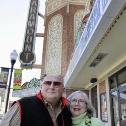 In this photo taken March 13, 2012, Richard and Arlene Hawks pose outside the Paramount Theatre in Aurora, Ill. The Hawks recently were named chairmen of the Paramount Arts Centre Endowment to provide funding for the 1,888-seat, 1930's art deco theater. With their support and leadership over the years, the Paramount already has been restored to its former glory, added a 12,000-square-foot Grand Gallery, hired its first artistic director and successfully launched a locally produced Broadway series.