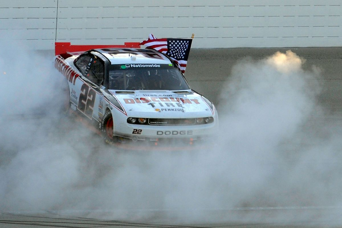 Brad Keselowski celebrates with a burnout after winning the NASCAR Nationwide Series Dollar General 300 at Chicagoland Speedway.