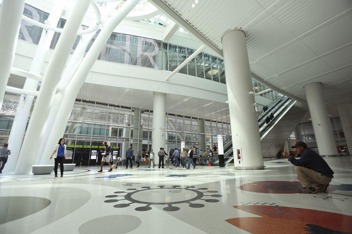 Tourists take photos inside the new San Francisco Transbay Transit Center
