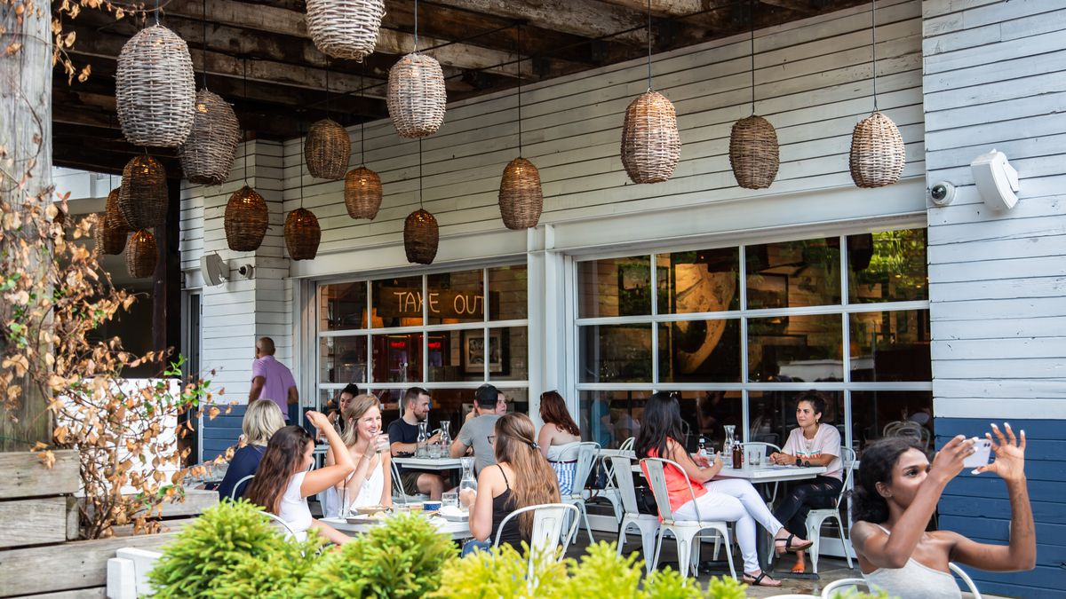 People dining on the patio at Bar Taco in Inman Park during COVID-19 in early July