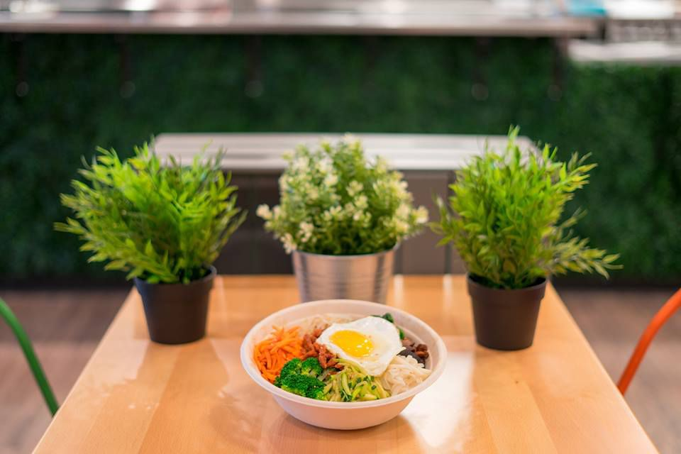 Korean dish in bowl on table with plants