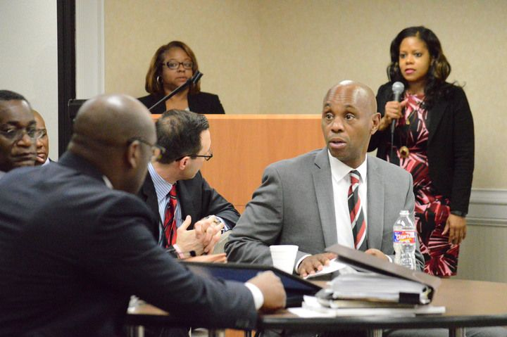 Superintendent Dorsey Hopson confers with staff.