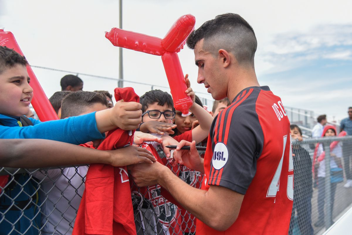 TFC II's Luca Uccello makes time for the fans after the 0-0 draw with the Richmond Kickers