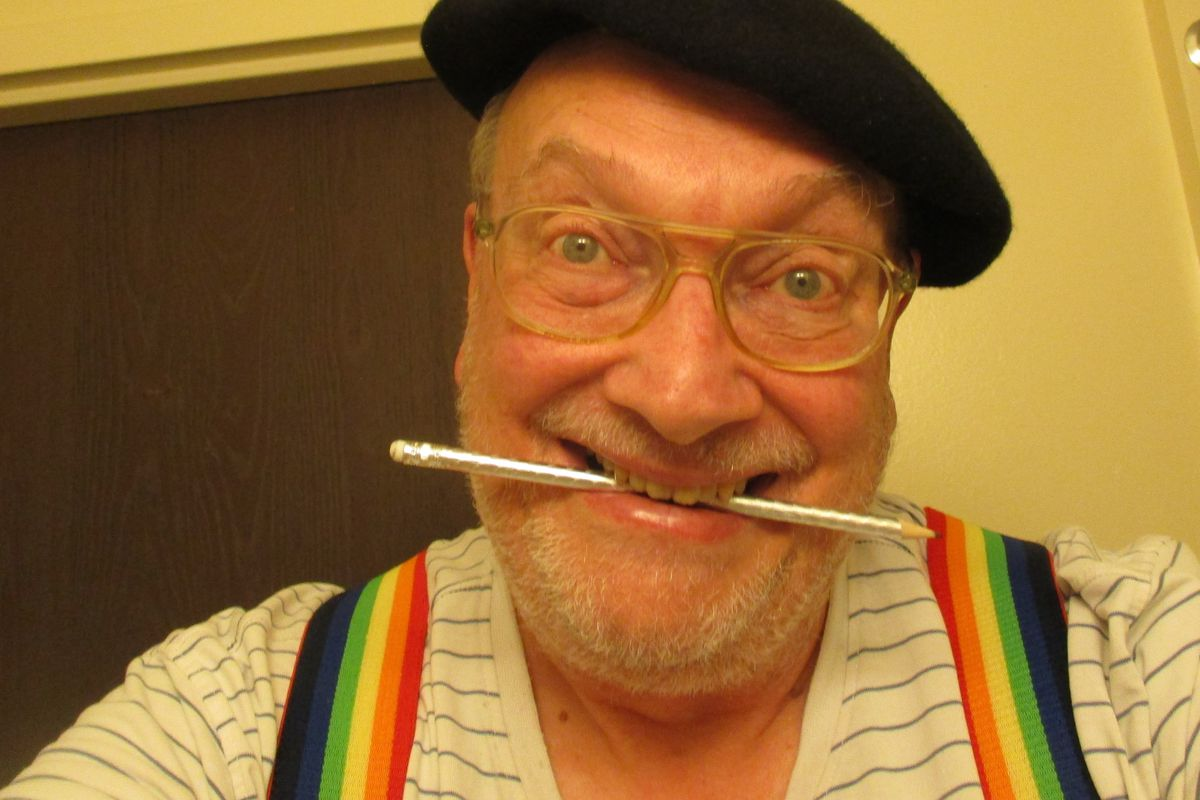 """Tim Torkildson poses for a selfie in his Provo home. He's proud to wear the rainbow suspenders. """"I even wear them to church on Sundays,"""" he said."""