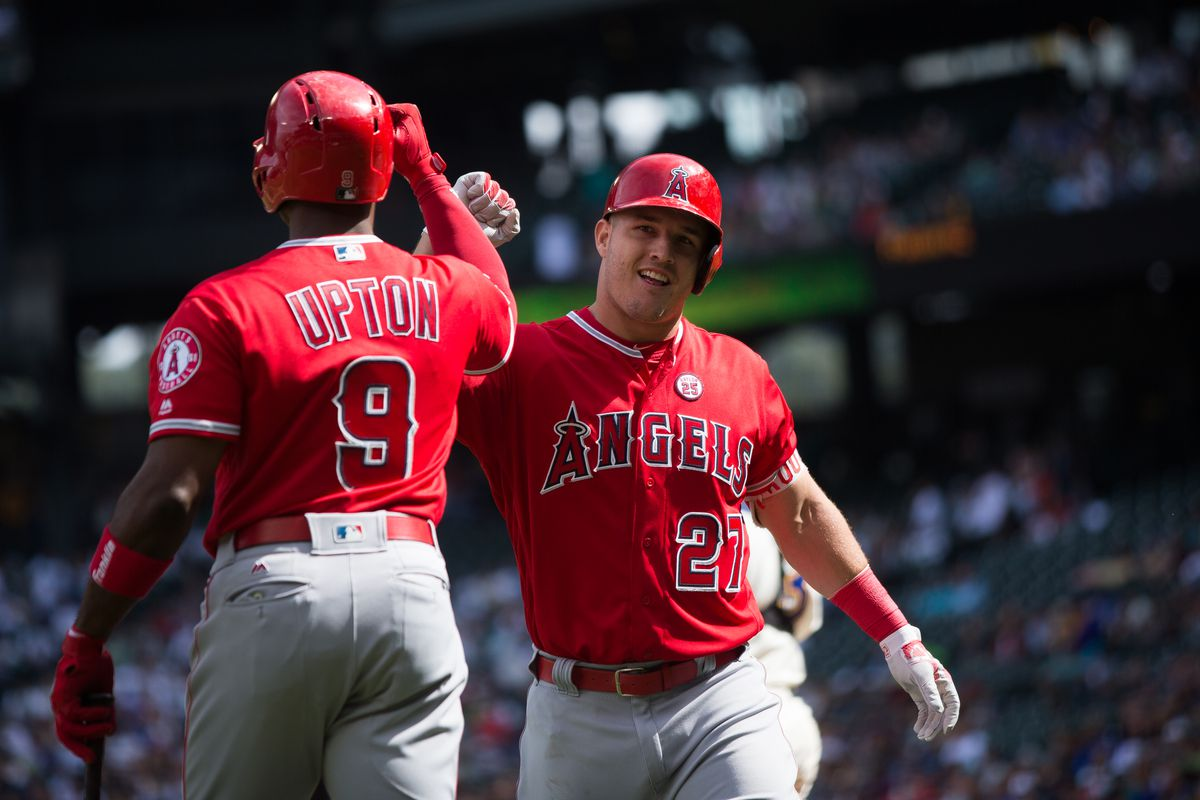 SEATTLE, WA - SEPTEMBER 10:  Mike Trout #27 of the Los Angeles Angels of Anaheim celebrates his solo home run in the first inning with Justin Upton #9 against the Seattle Mariners at Safeco Field on September 10, 2017 in Seattle, Washington. (Photo by Lindsey Wasson/Getty Images)
