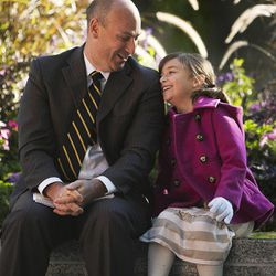 Seth Hassell laughs with his daughter Londin prior to the morning session of the 183rd Semiannual General Conference for The Church of Jesus Christ of Latter-day Saints Sunday, Oct. 6, 2013.