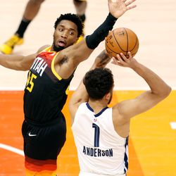 Utah Jazz guard Donovan Mitchell (45) tries to defend Memphis Grizzlies forward Kyle Anderson (1) as he passes the ball duringGame 5 of an NBA basketball first-round playoff series at Vivint Arena in Salt Lake City on Wednesday, June 2, 2021.