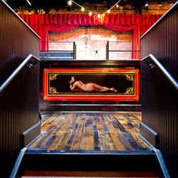 The focus of Black Jack's bar is a picture of a woman who has been digitally tattooed.