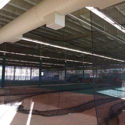 Inside batting cage building
