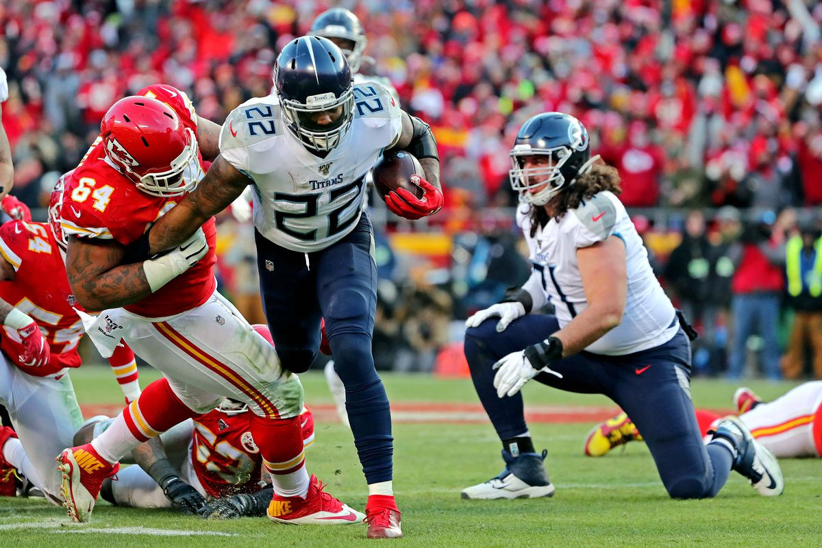 Kansas City Chiefs defensive tackle Mike Pennel tackles Tennessee Titans running back Derrick Henry during the second half in the AFC Championship Game at Arrowhead Stadium.