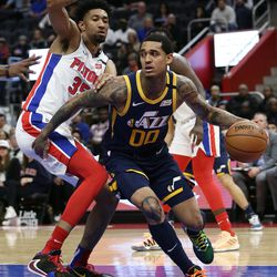 Utah Jazz guard Jordan Clarkson (00) looks to pass the ball against Detroit Pistons forward Christian Wood (35) during the second half of an NBA basketball game Saturday, March 7, 2020, in Detroit.