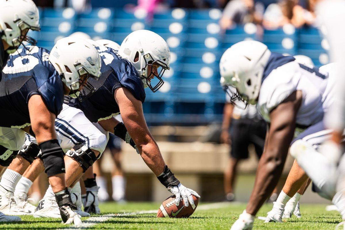 BYU center James Empey prepares to snap the ball during the Cougars' scrimmage at LaVell Edwards Stadium on Saturday, Aug. 10, 2019.