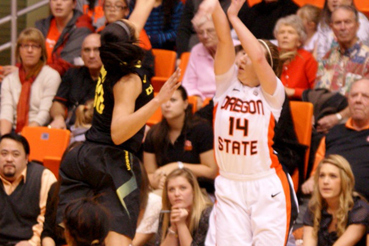 Ali Gibson connects on a 3 pointer that put Oregon St. ahead 62-57 with 1:46 remaining. Gibson had a career high 23 points to lead the Beavers to a 7 point Civil War win over Oregon. <em>(Photo be Andy Wooldridge)</em>