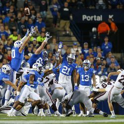 BYU defensive players try to block a field goal attempt by Mississippi State Bulldogs place-kicker Westin Graves (25) during play in Provo at LaVell Edwards Stadium on Friday, Oct. 14, 2016.