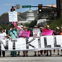 Protesters opposed to a Senate GOP health care bill block State Street during a protest in Salt Lake City on Tuesday, June 27, 2017.