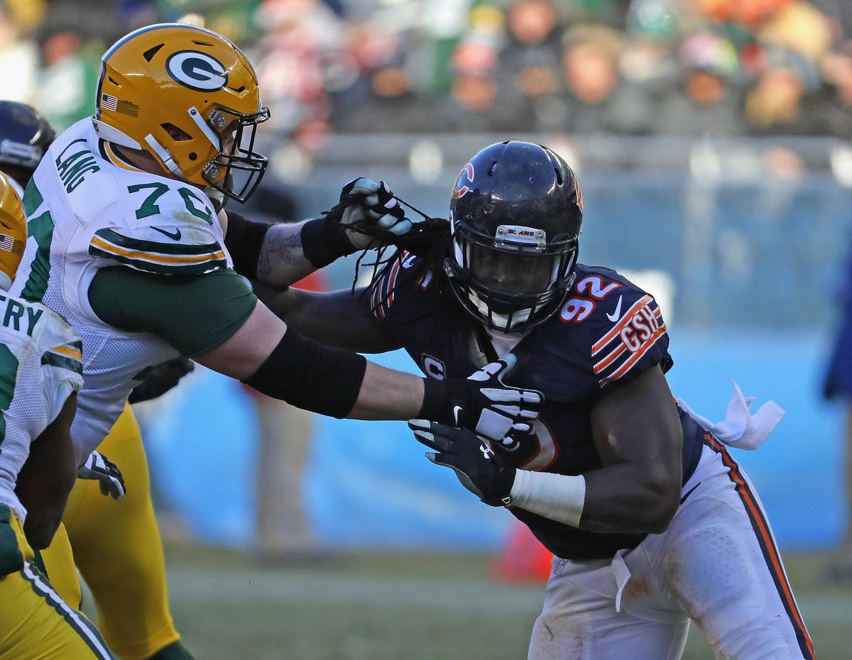 CHICAGO, IL - Green Bay Packers guard T.J. Lang (70) blocks Chicago Bears lineman Pernell McPhee (92) at Soldier Field.