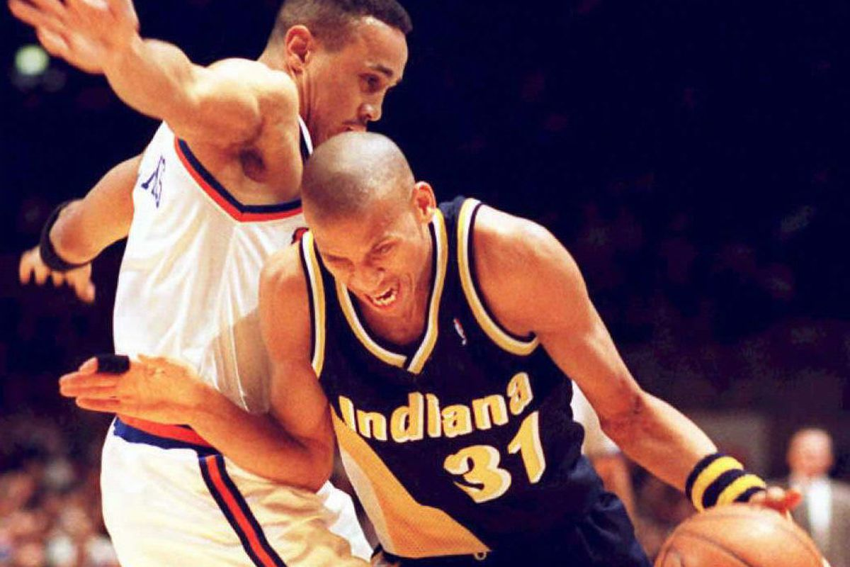 Indiana Pacers Reggie Miller (R) shouts as he runs