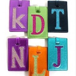 """Assorted Kitson initial luggage tags, $12 at <a href=""""http://www.shopkitson.com/index.php?page=product&id=3851""""target=""""_blank"""">Kitson</a>"""