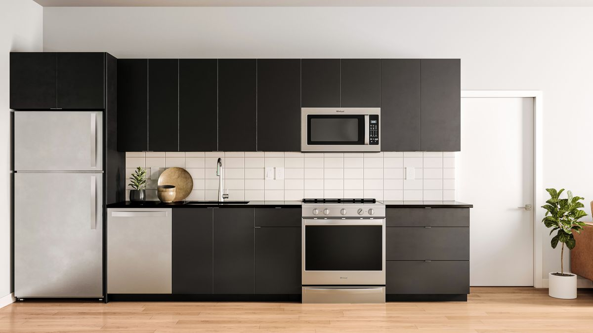 Rendering of a kitchen with black cabinets, white tile backsplash, and stainless steel appliances.