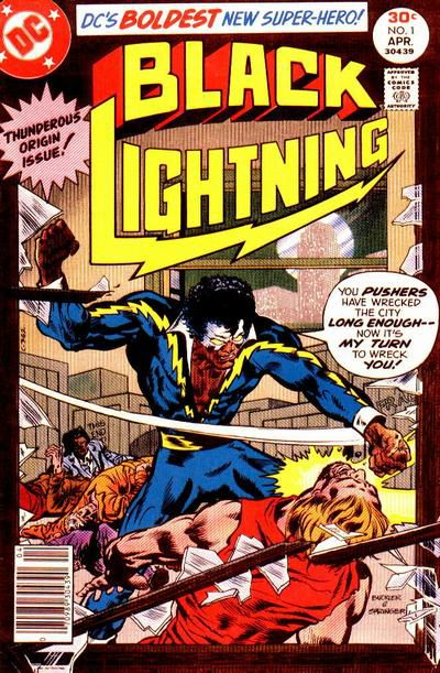 """Black Lightning, in a blue, yellow, and black costume, white mask, and afro, slugs a criminal in a warehouse, saying """"You pushers have wrecked the city long enough — now it's my turn to wreck you!"""" on the cover of Black Lightning #1, DC Comics (1977)."""
