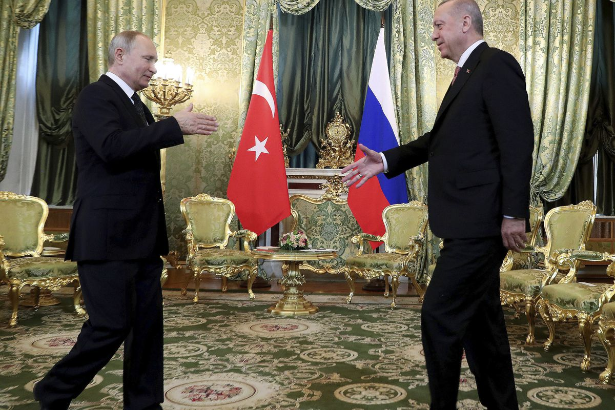 Russia's President Vladimir Putin, left, walks to shake hands with Turkey's President Recep Tayyip Erdogan, right, as he welcomes him prior to their meeting in Moscow, Russia, Monday, April 8, 2019. Russian President Vladimir Putin is hosting his Turkish
