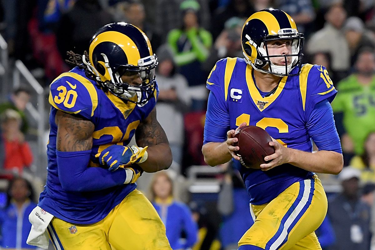 Quarterback Jared Goff of the Los Angeles Rams fakes a handoff to running back Todd Gurley during the game against the Seattle Seahawks at Los Angeles Memorial Coliseum on December 08, 2019 in Los Angeles, California.