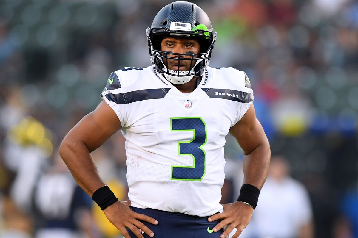 Russell Wilson #3 of the Seattle Seahawks reacts as a touchdown is called back after a Seahawk penalty during the first quarter of a presseason game against the Los Angeles Chargers at StubHub Center on August 18, 2018 in Carson, California.