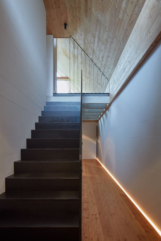 Staircase leading up to a bright area.