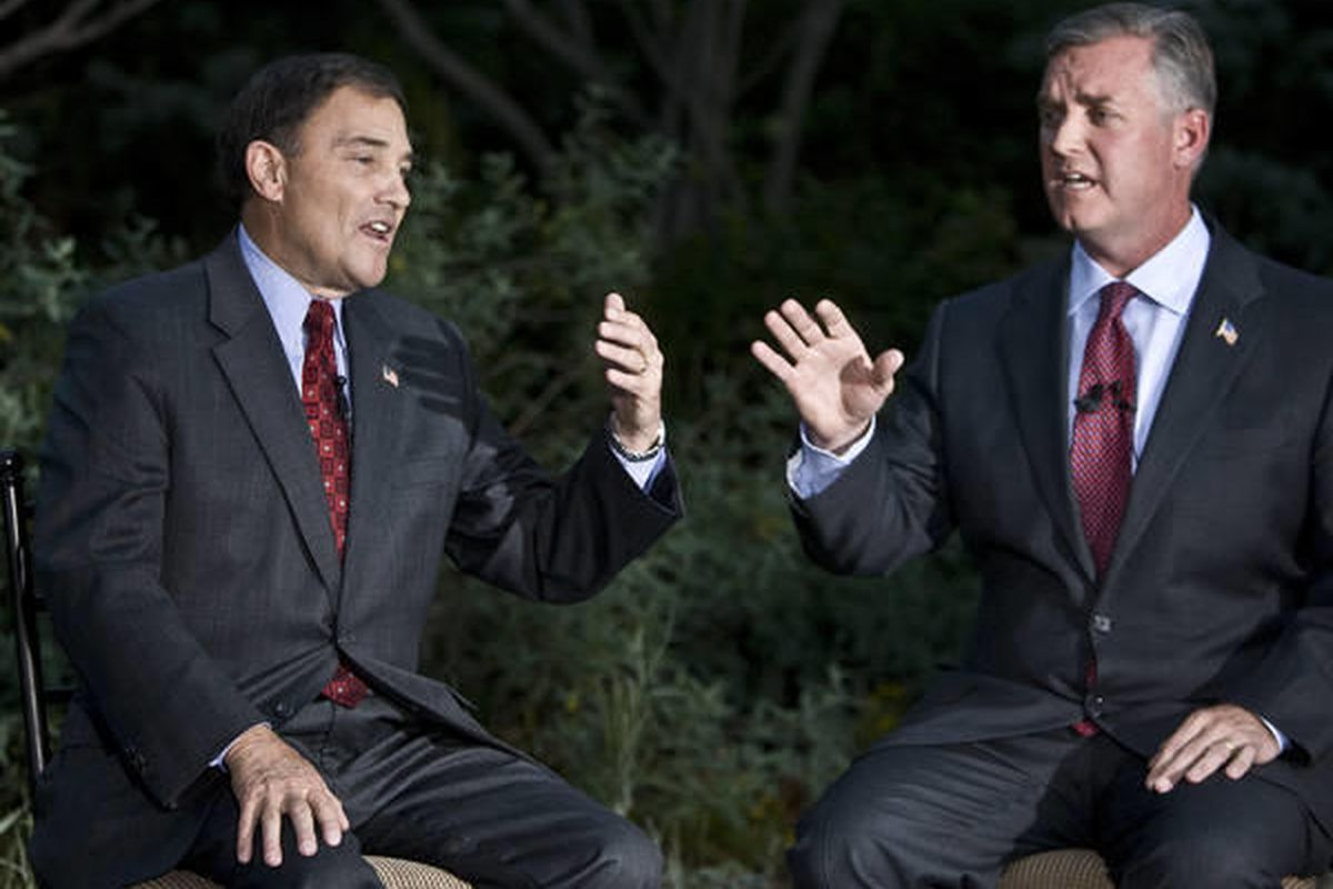 GOP Gov. Gary Herbert, left, speaks during a debate with Democratic challenger Salt Lake Mayor Peter Corroon outside of the Channel 2 News Studios in Salt Lake City last month. Herbert's lead continues to widen over Corroon, according to a new Deseret New