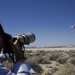 Space Shuttle Endeavour mounted on NASA's Shuttle Carrier Aircraft (SCA) flies over Edwards Air Force Base, Calif., Thursday, Sept. 20, 2012. (AP Photo/Jae C. Hong)