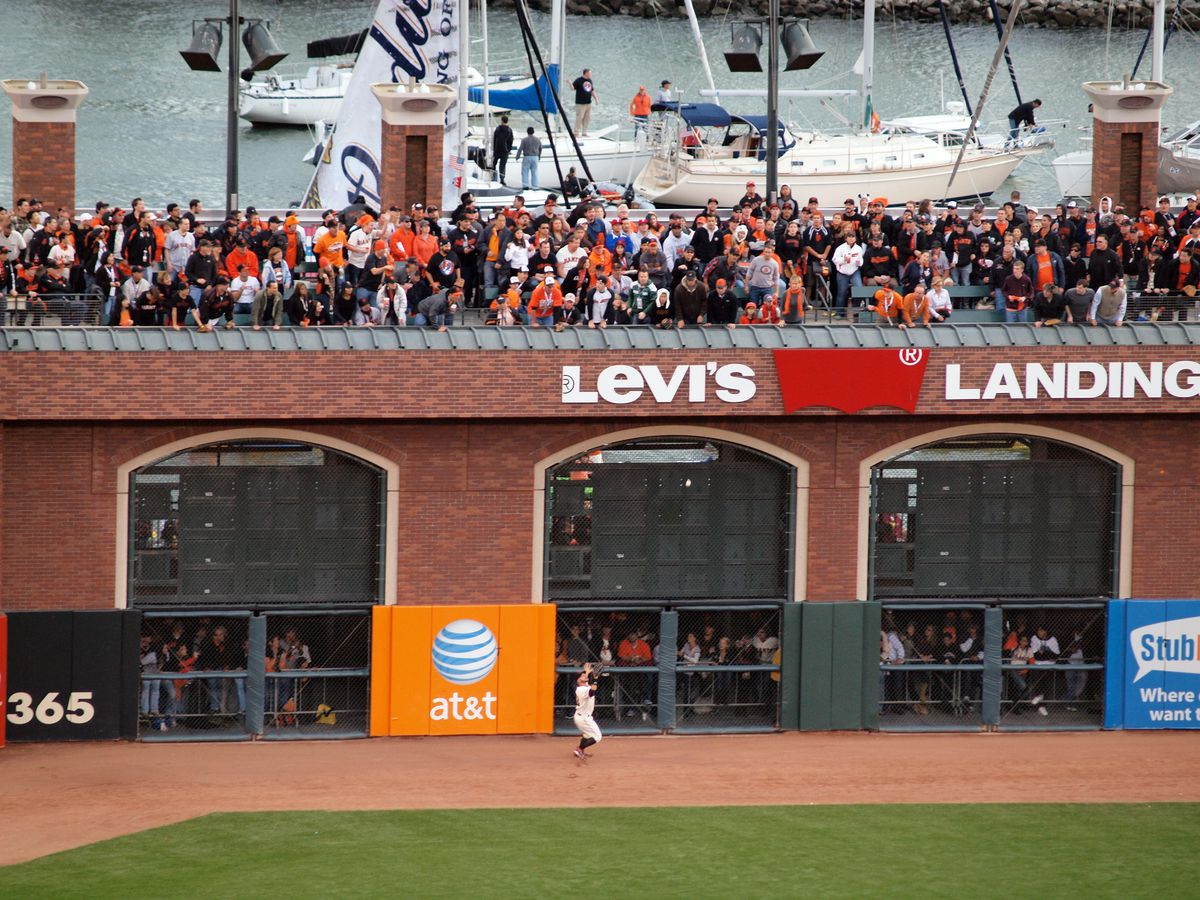 Outfielder Cody Ross reaches glove into the air at game 2 of the 2010 World Series between Giants and Rangers.