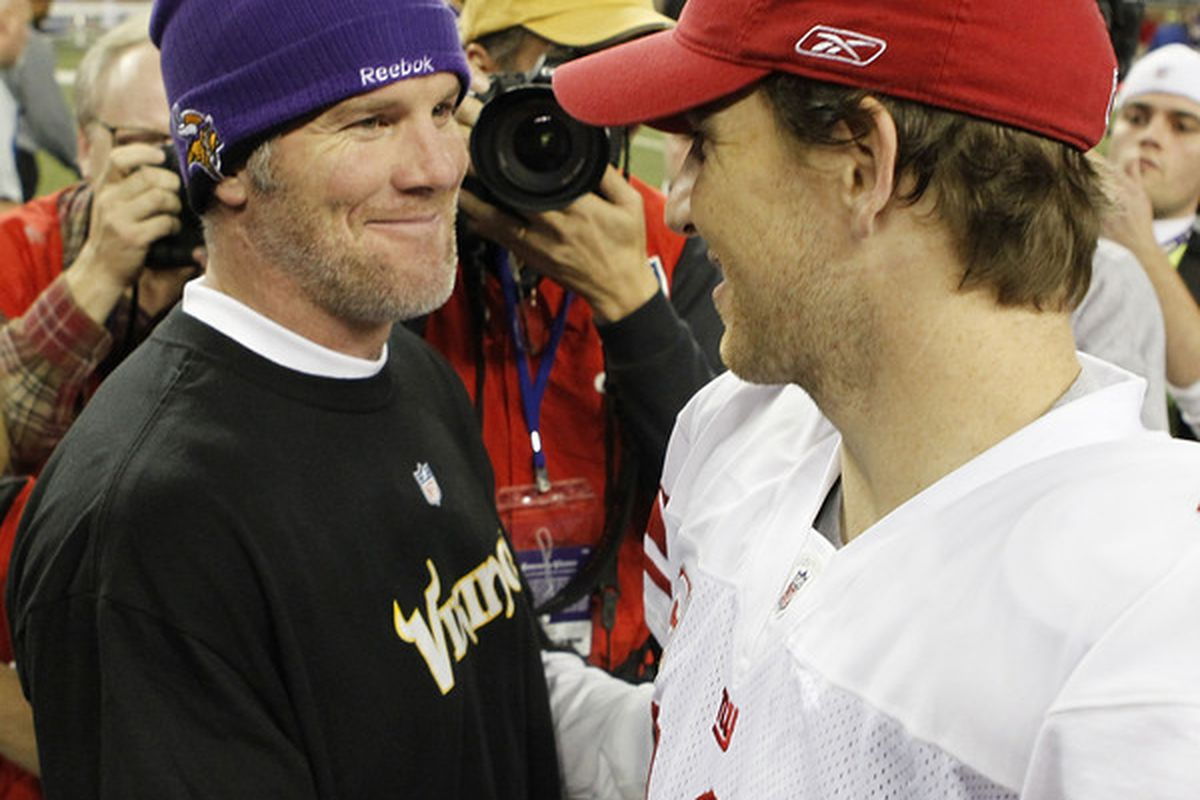 Brett Favre (4) of the Minnesota Vikings talks with Eli Manning (10) of the New York Giants after that game at Ford Field on December 13 2010 in Detroit Michigan. The Giants defeated the Vikings 21-3.  (Photo by Leon Halip/Getty Images)