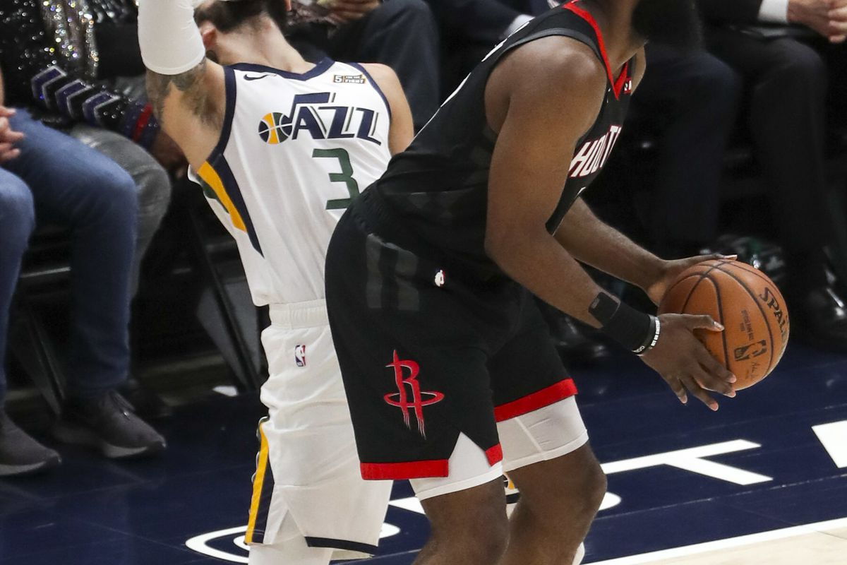Utah Jazz guard Ricky Rubio (3) holds his face after Houston Rockets guard James Harden (13) elbowed him in the mouth during Game 4 of the NBA Playoffs at Vivint Smart Home Arena in Salt Lake City on Monday, April 22, 2019.